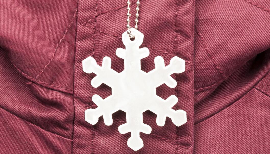 Reflex formad som snöflinga