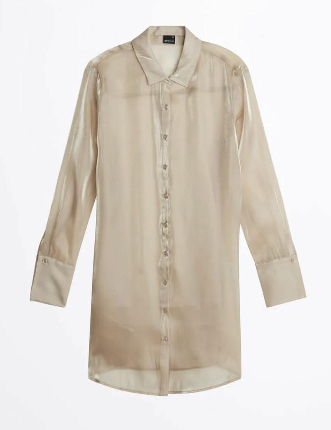 Beige skjorta i lång modell från Gina tricot