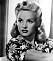 """Skådespelerskan, dansaren och modellen Betty Grable i frisyr """"victory rolls""""."""