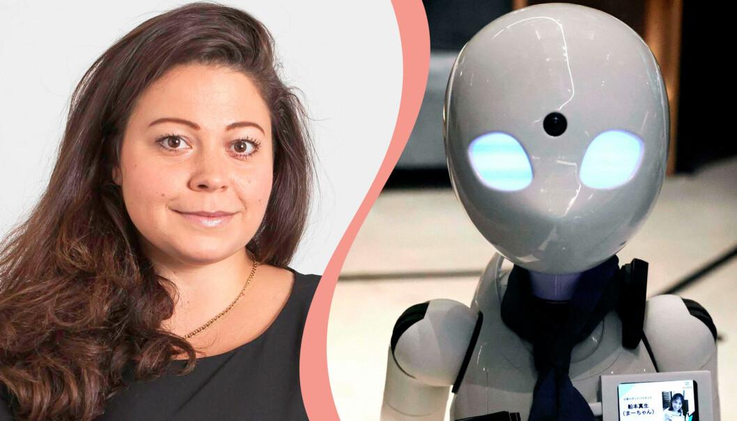 Claudia Olsson och en robot från Japan