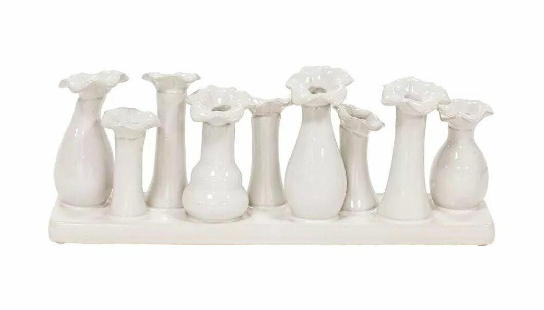 Vas med nio små vaser i en.