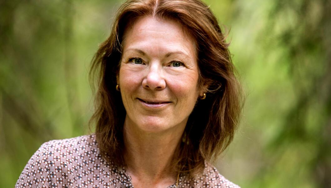 Porträtt av Christine Busain som skogsbadar för att må bättre