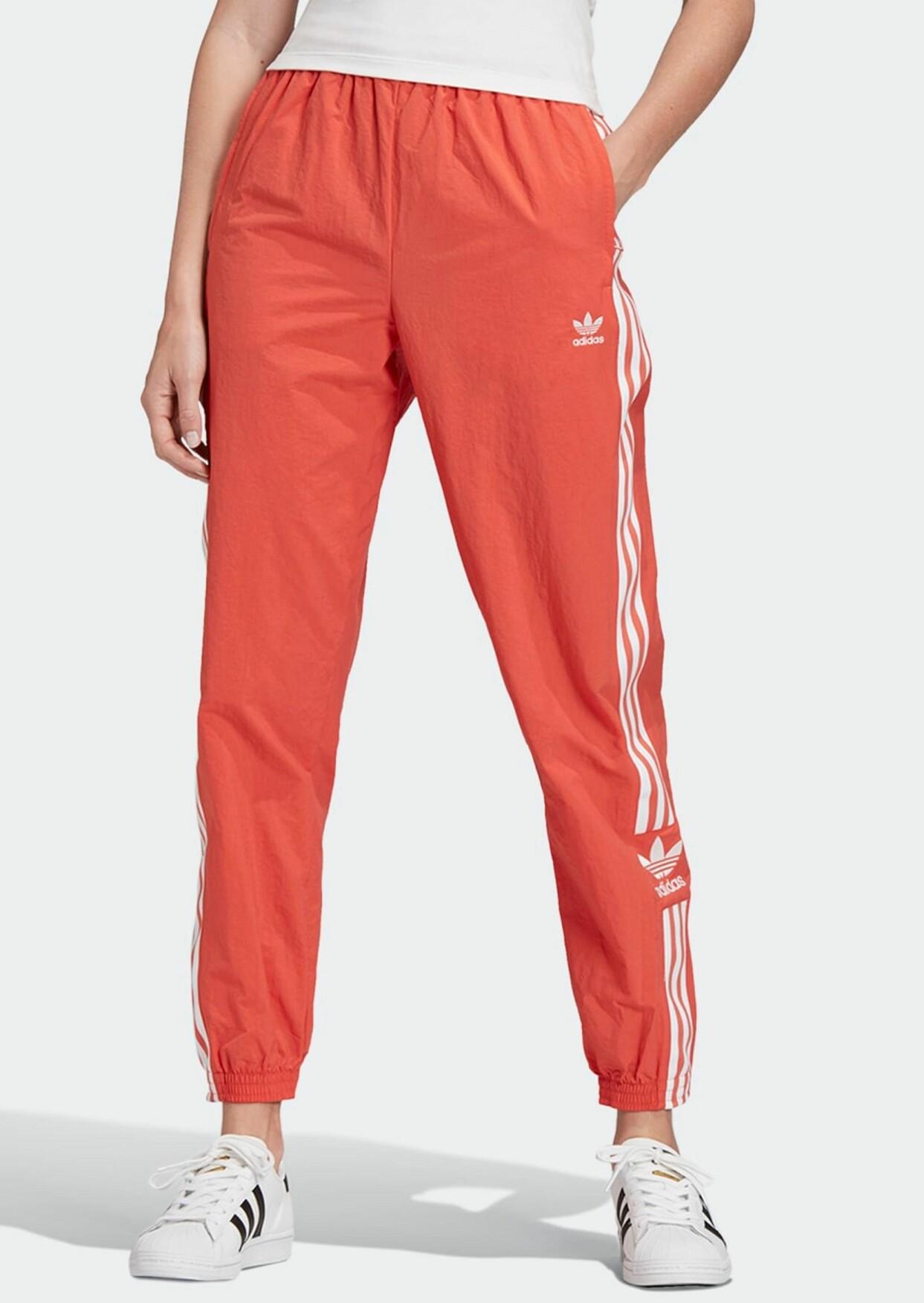 Orange träningsbyxor från Adidas Originals