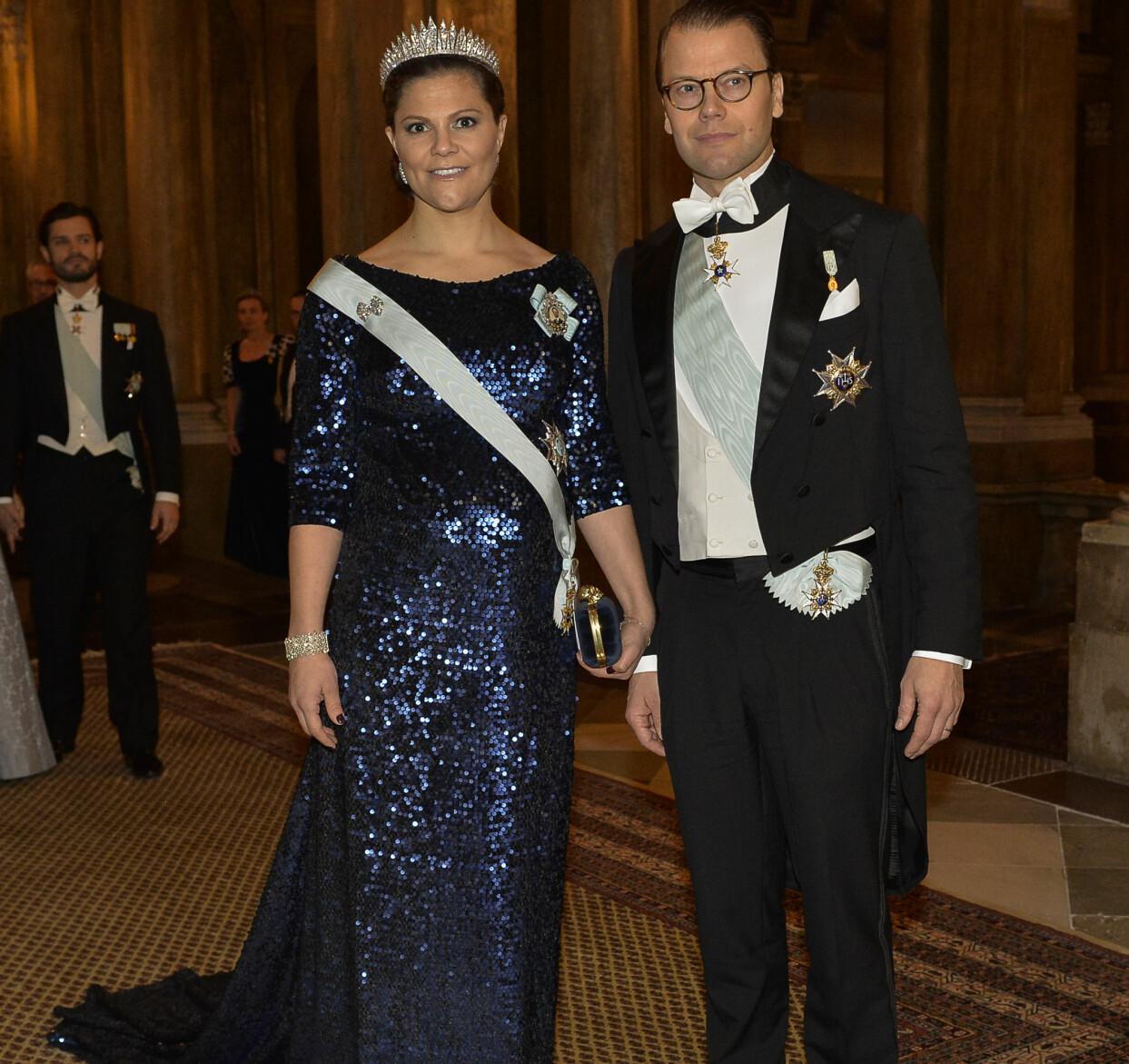Kronprinsessan Victoria och prins Daniel under kungamiddagen i slottet i Stockholm 2015.
