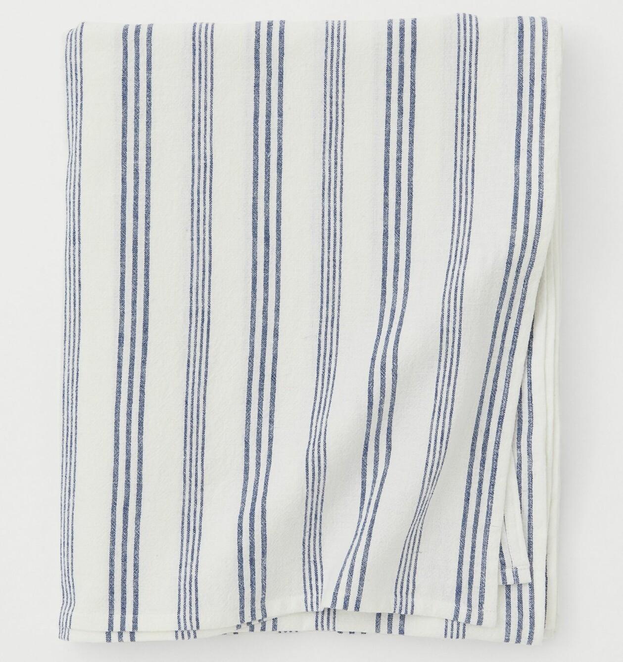 Smalrandig linneduk i blått och vitt, från H&M Home