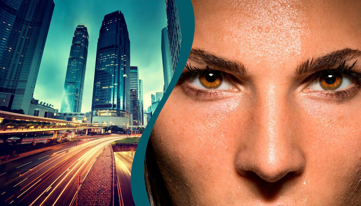 Stad och närbild på en kvinnas ansikte med intensiva ögon.